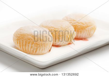 Beautiful and delicious japanese mochi rice cakes on a rectangular dish isolated on white background