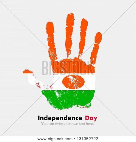 Hand print, which bears the Flag of Niger. Independence Day. Grunge style. Grungy hand print with the flag. Hand print and five fingers. Used as an icon, card, greeting, printed materials.