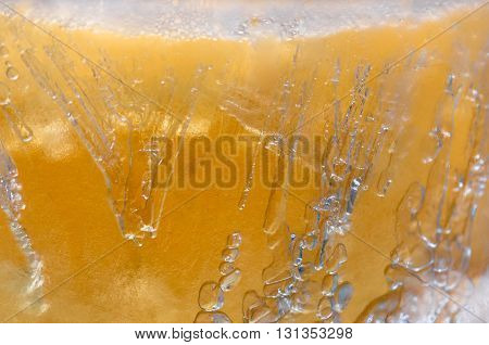 big bubbles in a frozen light beer close