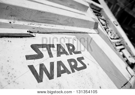 Podol, Ukraine - May 19, 2016: Star Wars Logo On Flying Space Machine. Black And White Photo