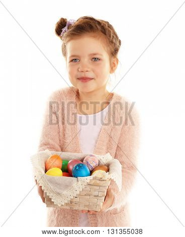 Little girl holding wicker basket with Easter eggs isolated on white