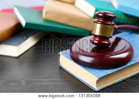 Judge gavel and books on wooden table