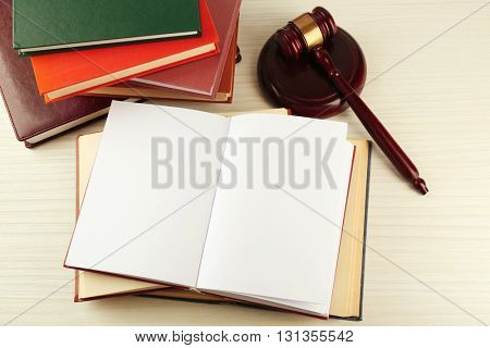 Blank open book with gavel on table