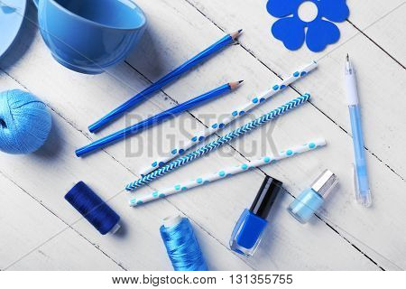 Blue colour flat lay composition on white wooden background
