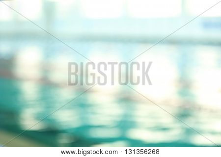 Defocused background of swimming pool indoors