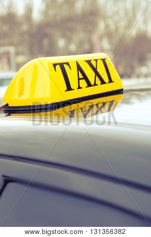 Taxi sign on car, closeup