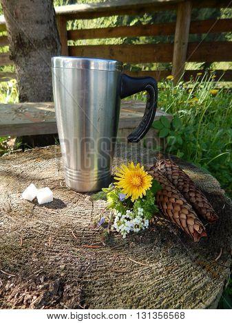 Mug of herbal tea for breakfast outdoors