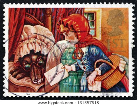 GREAT BRITAIN - CIRCA 1994: a stamp printed in Great Britain shows Little Red Riding Hood and the Wolf Fairy Tale circa 1994