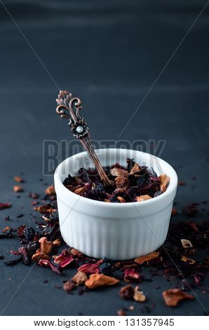 Mixture herbal floral fruit tea with petals, dry berries and fruits