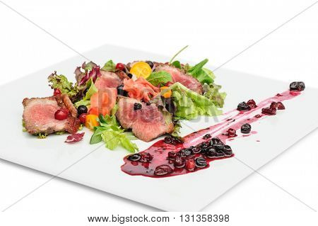 Grilled meat with cranberry and blackcurrant sauce