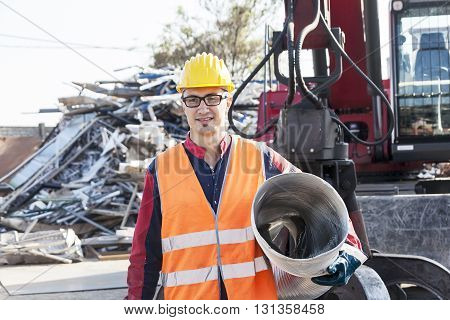 man at work in landfills carries iron scrab