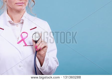 Pink Ribbon With Stethoscope On Medical Uniform.