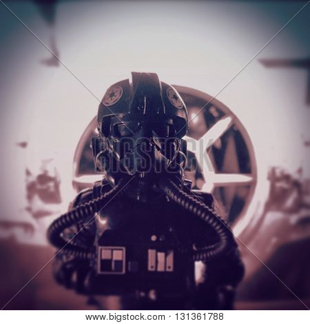 BLOOMFIELD NJ - MAY 23 2016: Hasbro Star Wars Black Series figure of an Imperial Tie Fighter Pilot stands in front of his Tie Fighter
