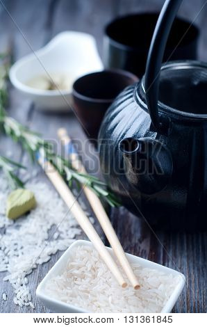 Chinese black teapot and teacups on backgraund