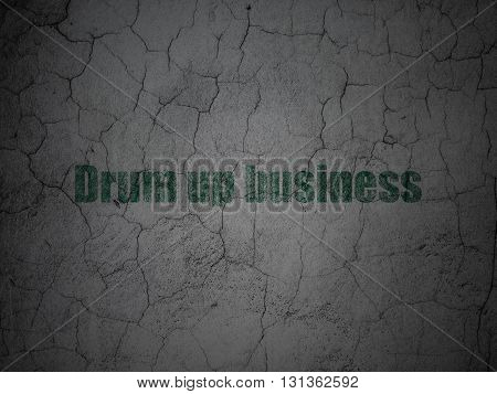 Finance concept: Green Drum up business on grunge textured concrete wall background