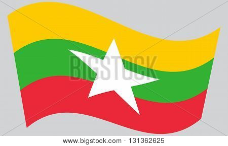 Flag of Myanmar waving on gray background