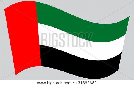 Flag of the United Arab Emirates waving on gray background