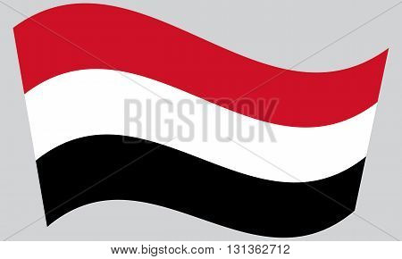 Flag of Yemen waving on gray background