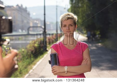 portrait of jogging woman before running  on early morning with sunrise in background