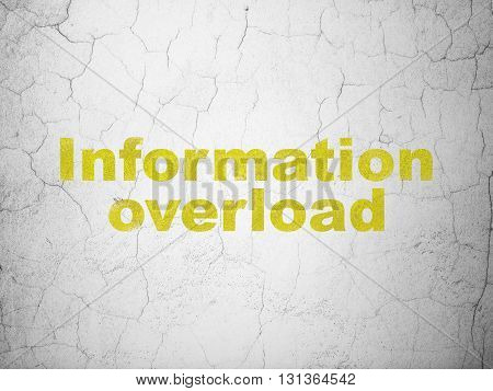 Information concept: Yellow Information Overload on textured concrete wall background