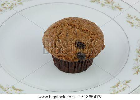 Breakfast Raisin bran muffin on white plate
