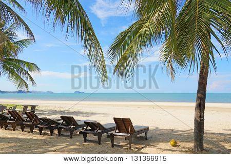Beach Chairs And Coconut Palm Tree At The Tropical Beach, Pranburi, Thailand.