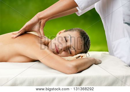 Healthy spa: young beautiful relaxing woman having moistening mask applied.