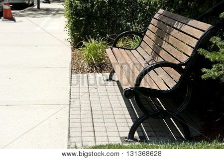 An profile of a wooden bench on a sunny day.