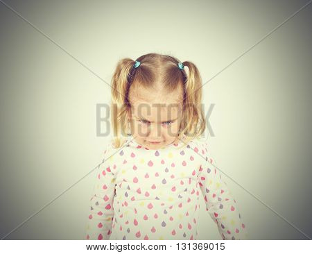 Little girl looking down hurt. Emotions. Blonde