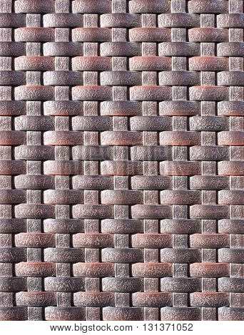 Brown weave plastic wicker pattern for background.
