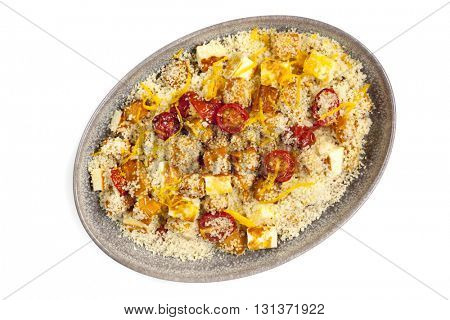 Couscous with roasted pumpkin, tomatoes and grilled halloumi cheese, isolated on white.  With orange zest.