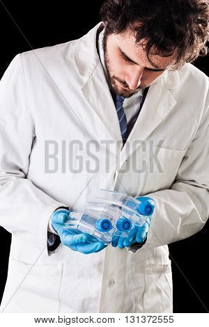 Biologist Holding Culture Flasks