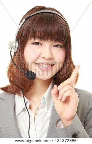 studio shot of young Japanese businesswoman presenting and showing something on white background