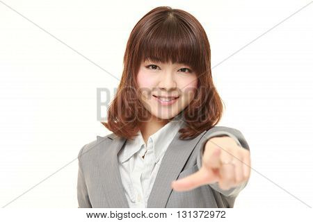 studio shot of Japanese businesswoman decided on white background