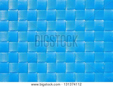 Blue weave plastic wicker pattern for background.