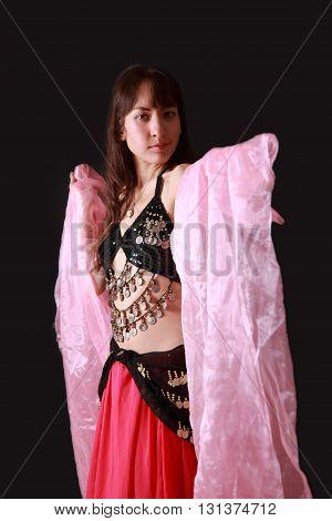 studio shot of belly dancer on black background