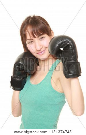 studio shot of female boxer with punching glovesthrows on a fight position