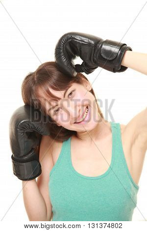studio shot of female boxer smiles on white background