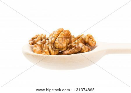 Wooden spoon full with walnuts. Isolated on a white background