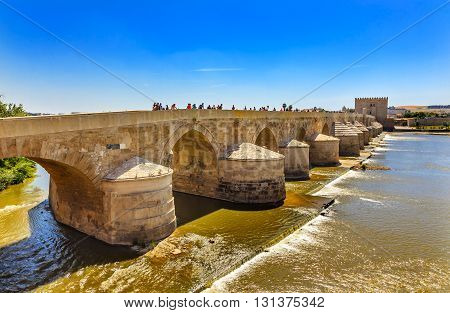 CORDOBA, SPAIN - MAY 15, 2014 Ancient Roman Bridge Entrance River Guadalquivir Cordoba Spain Roman bridge was built in the 1st Century BC.