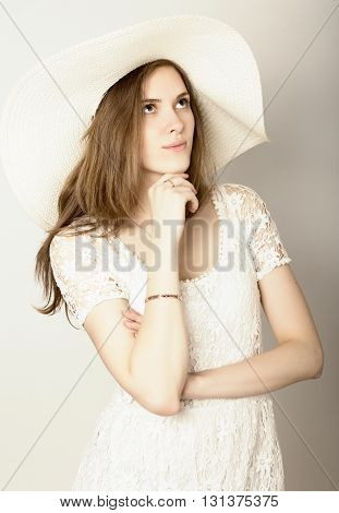 beautiful girl in broad-brimmed hat posing and expresses different emotions. dreaminess.