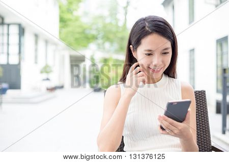 Young Woman sending message on mobile phone