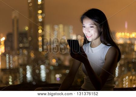 Young woman use of cellphone at night