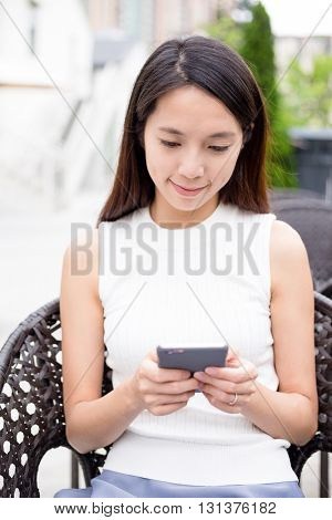 Asian Woman use of phone