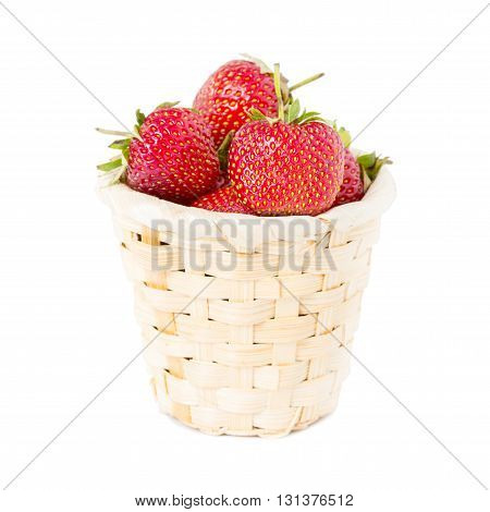 Strawberries in a basket. Isolated on white background