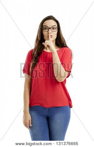 Lovey woman with her finger on her lips and asking for silence