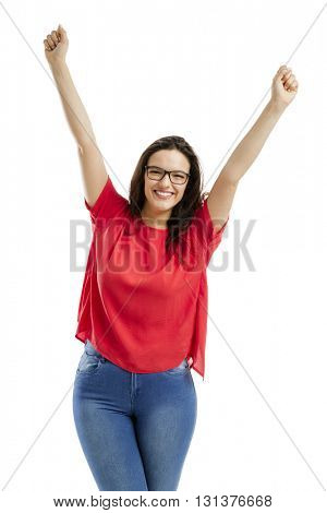 Happy woman with arms up, isolated over white background