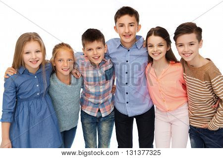 childhood, fashion, friendship and people concept - happy smiling children hugging