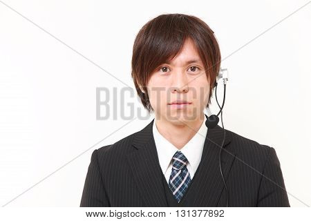 studio shot of young Japanese businessman of call center on white background