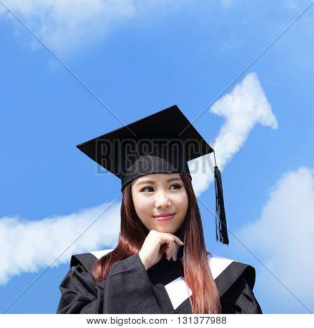 happy graduate student girl look up with cloud arrow in the sky she wear graduation cap and gown asian